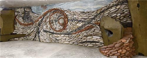美艺术家夫妇用岩石,鹅卵石制作繁星卵石墙(组图)
