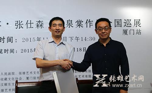 张雄艺术文化有限公司董事长张雄先生(左)与中国人民画院院长张仕森先生(右)成功签约